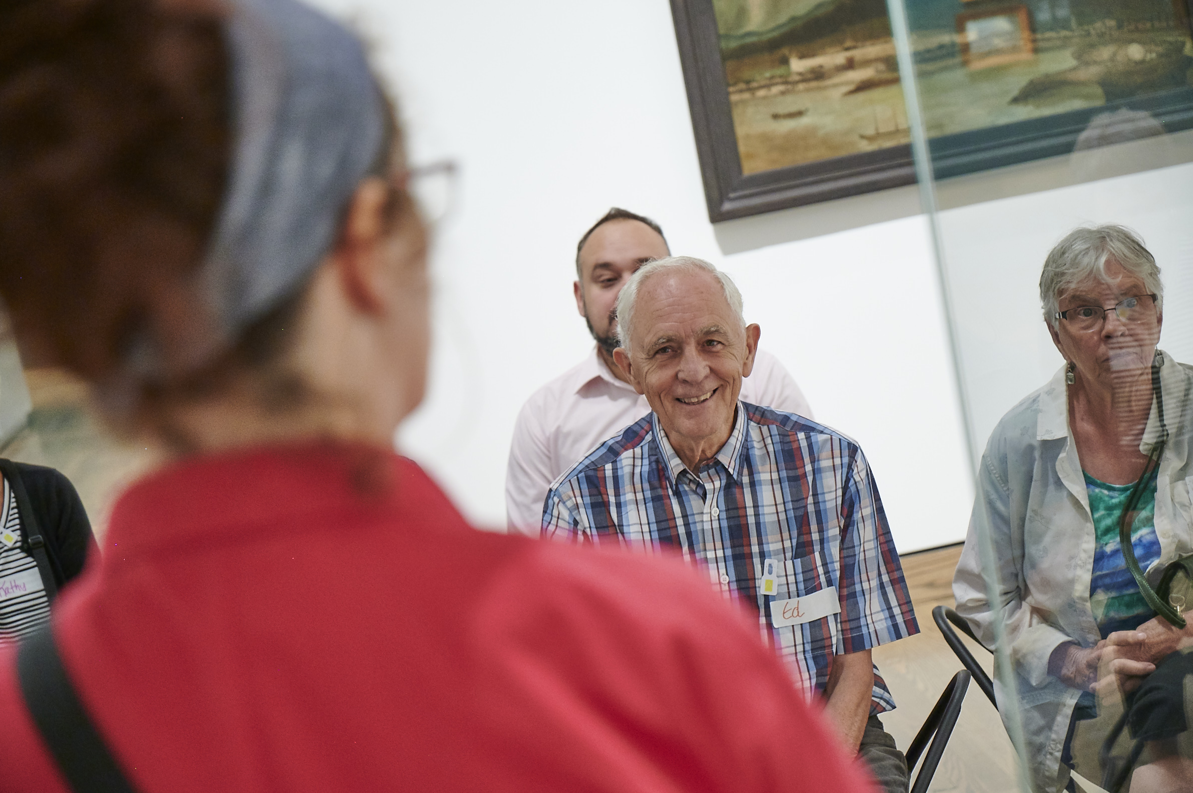 people looking at art in a gallery